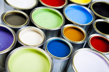 bigstock_Cans_and_paint_on_the_colorful_27702014